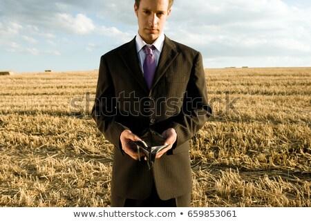 Férfi tart üres pénztárca búzamező égbolt Stock fotó © IS2