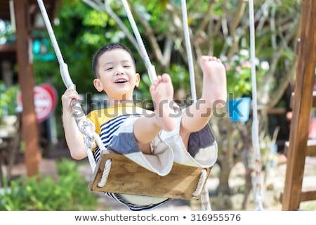 Little Asian boy in swing Stock photo © kenishirotie