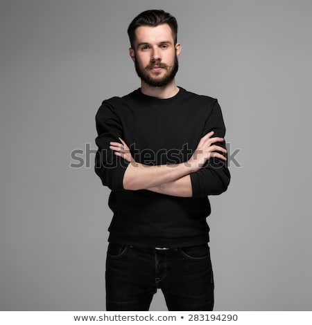 handsome macho man in black clothes standing Stock photo © feedough