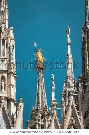 Golden Virgin Mary statue on top roof of Duomo Stock photo © vapi