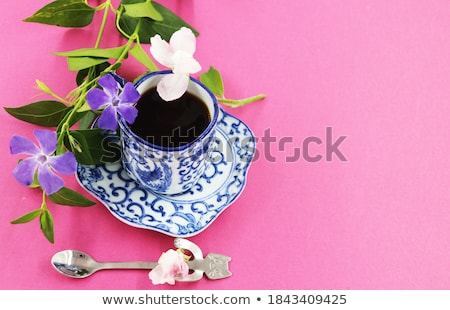 Coffee cup and white flowers on black background Stock photo © dashapetrenko