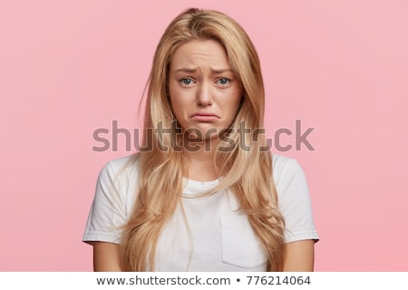 Portrait of a shocked blonde haired young woman Stock photo © deandrobot