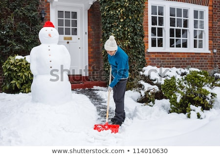 woman shoveling and removing snow outside Stock photo © Lopolo