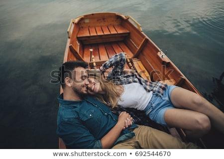 Stok fotoğraf: Loving Couple Rowing On The Lake