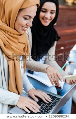 Arkadaşlar Müslüman kadın oturma açık havada Stok fotoğraf © deandrobot