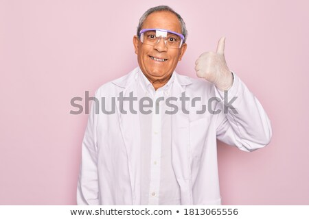 elderly doctor scientist smile thumb up like gesture Stock photo © studiostoks