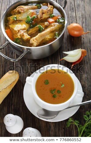 Chicken bone broth with fresh vegetables, top view Stock photo © madeleine_steinbach