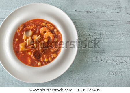 Tazón espanol peces chorizo sopa mesa de madera Foto stock © Alex9500
