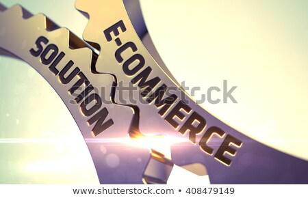 E-Commerce Solutions on the Golden Cogwheel. 3D. Photo stock © tashatuvango