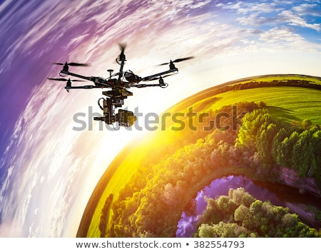 multicopter drone flying high over landscape Stock photo © unkreatives
