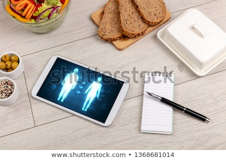 Arrangement of healthy Ingredients with a tablet. Stock photo © ra2studio