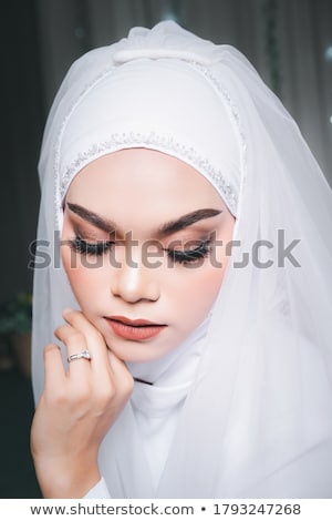 Young attractive Arabian female with natural makeup in hijab Stock photo © pressmaster