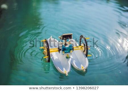 Toy ship robot in a blue pool Stock photo © galitskaya