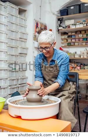 Idős női dolgozik cserépedények kerék ül Stock fotó © boggy