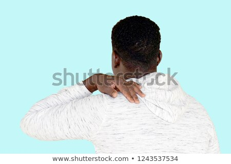 Close-up Of An African Man In Pain Scratching His Neck Stock photo © AndreyPopov