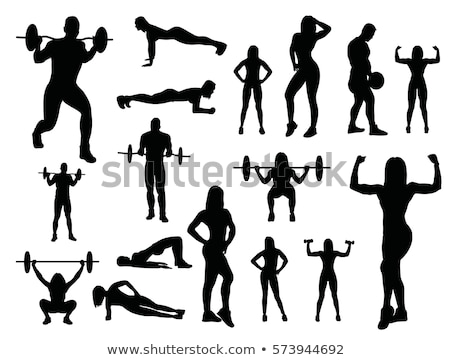 Silhouette of woman bodybuilder from back Stock photo © Paha_L