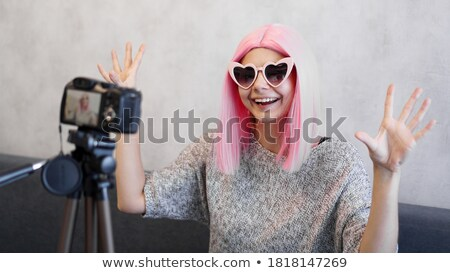 Stok fotoğraf: Beauty Young Girl Hairstyle She Is In Front Of The Camera And L