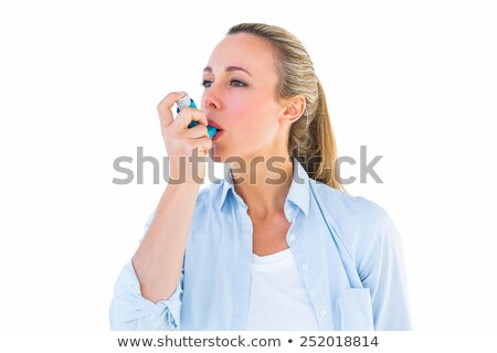 happy woman using asthma inhaler stock photo © wavebreak_media