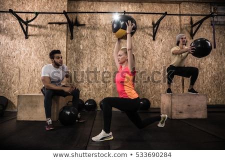 crossfit ball fitness workout group woman and man stock photo © lunamarina