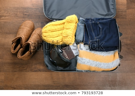 warming clothes in a suitcase Stock photo © nito