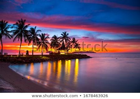 Pôr do sol céu quente nuvens sol laranja Foto stock © andrewroland