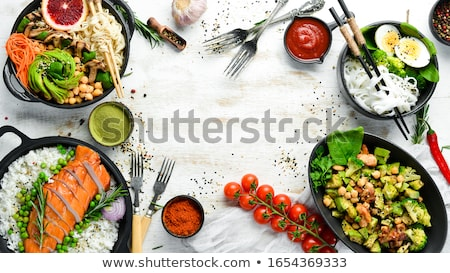 fresh salad with cheese on white wooden table stock photo © jeliva