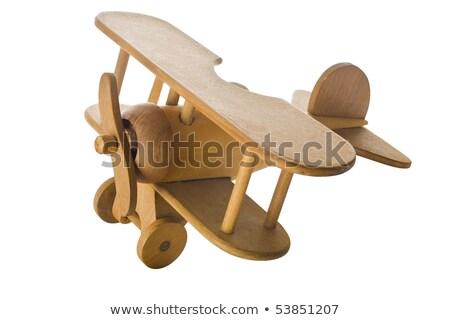 Brinquedo de madeira avião mão modelo piso de madeira educação Foto stock © stokkete