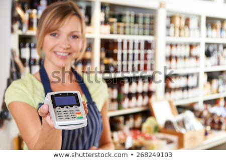 Sales Assistant In Food Store Handing Credit Card Machine To Cus Stock photo © HighwayStarz