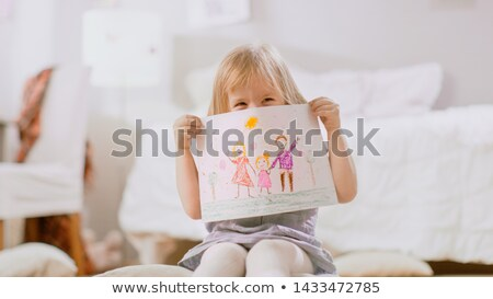 Child shows picture Stock photo © deyangeorgiev