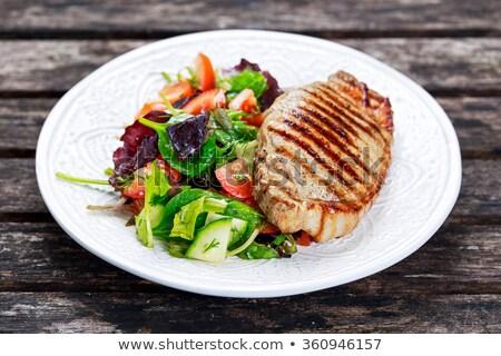 roast pork chop and salad greens stock photo © digifoodstock