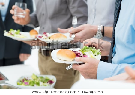 Stock photo: Group of business people having breakfast together