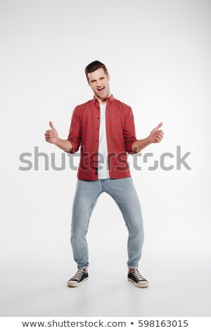 vertical image of screaming man showing thumbs up stock photo © deandrobot