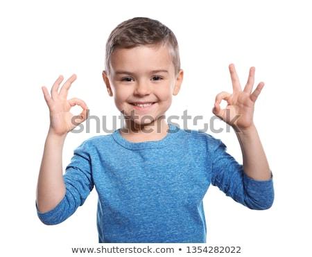 caucasian little boy showing ok sign stock photo © rastudio