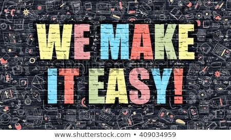 we make it easy on dark brick wall stock photo © tashatuvango