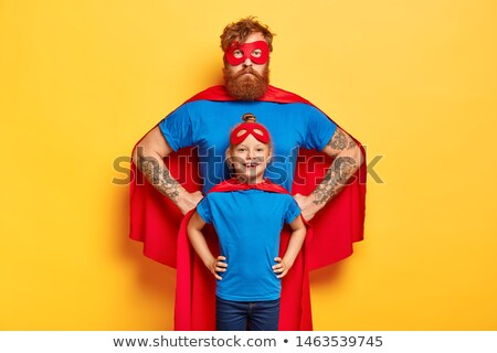 Portrait of father and daughter pretending to be superhero at home Stock photo © wavebreak_media