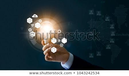 Сток-фото: Businessman Holding Lightbulb Sign