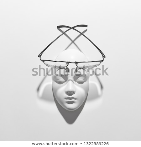 Gypsum face sculpture with elegant glasses with long crossing shadows on a white background, copy sp Stock photo © artjazz