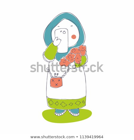 Young mobile female in hijab taking photo of flowers on smartphone camera Stock photo © pressmaster