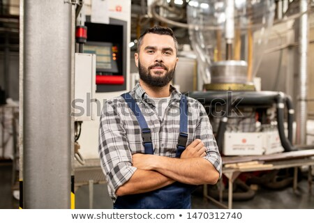 Young polymer processing tube engineer with his arms crossed by chest Stock photo © pressmaster