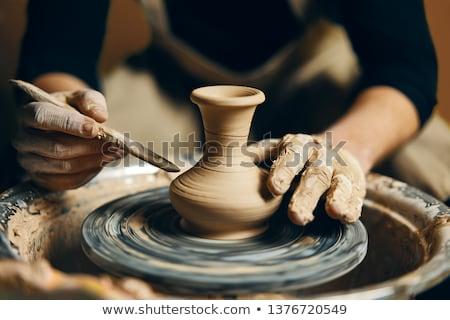 Hands working on potter's wheel Stock photo © tilo