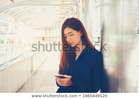 Hand charging phone with reports concept Stock photo © ra2studio
