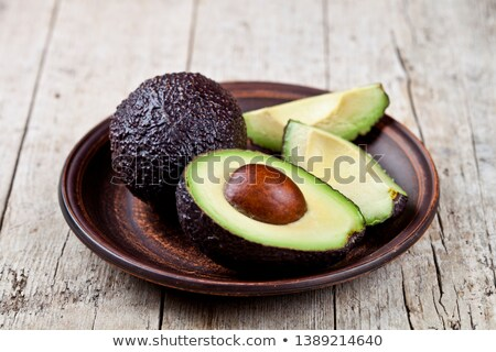 Fresh organic avocado on ceramic plate on rustic wooden table ba Stock photo © marylooo