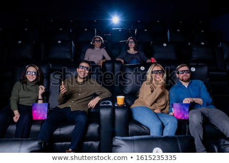 Large group of happy young friends in 3d eyeglasses spending leisure in cinema Stock photo © pressmaster