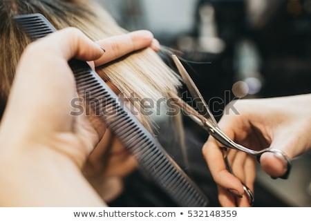 male hairdresser cutting hair at barbershop Stock photo © dolgachov