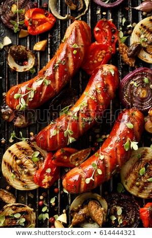Alla griglia salsicce verdura spezie erbe top Foto d'archivio © karandaev