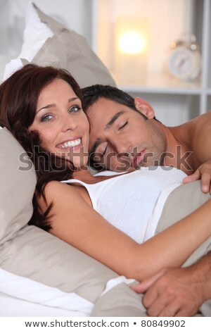 Woman asleep on a green duvet Stock photo © photography33