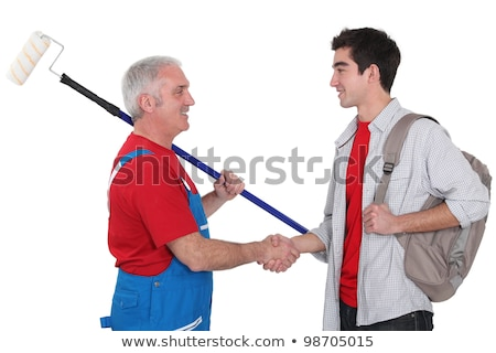 experienced tradesman welcoming his new recruit stock photo © photography33