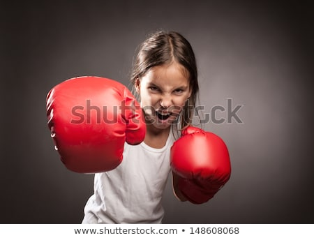 Little girl wearing boxing gloves Stock photo © photography33