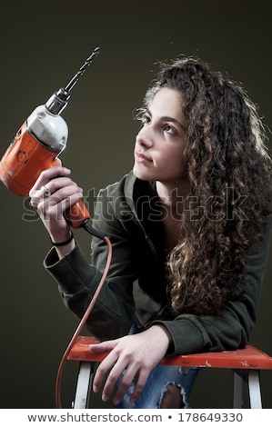 Stock photo: Woman holding power drill