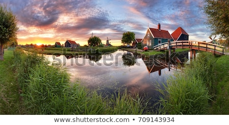 Landscape of lake and village Stock photo © raywoo